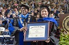 Madam Xu Lin from China sang an Elvis Presley song during the MTSU graduation ceremony