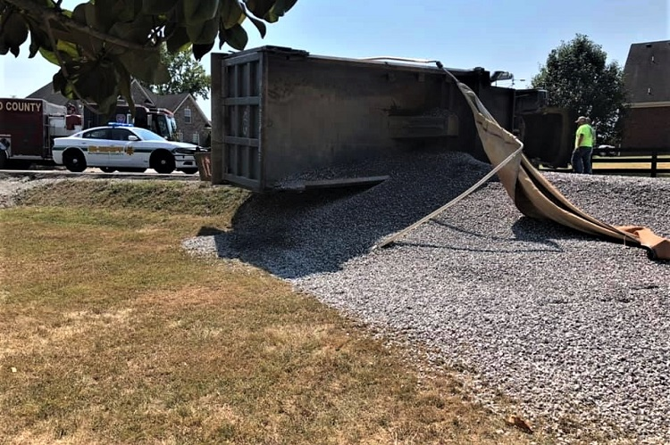 Dump Truck Rolled and Spilled Gravel