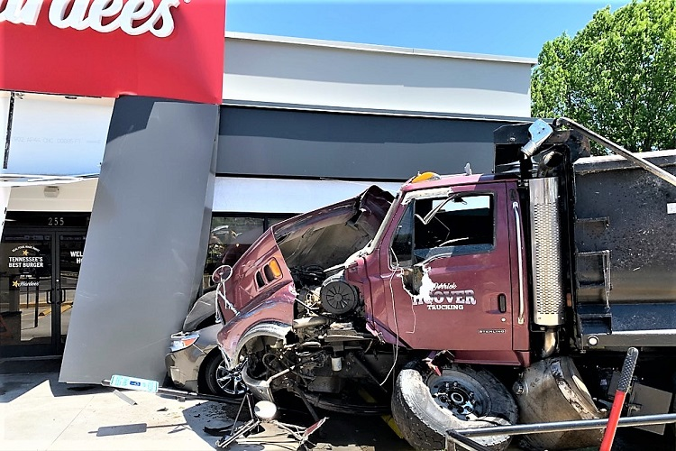 A Saturday morning traffic accident sent three to the hospital, closed roads, and closed Hardee's at 255 South Lowry Street in Smyrna.