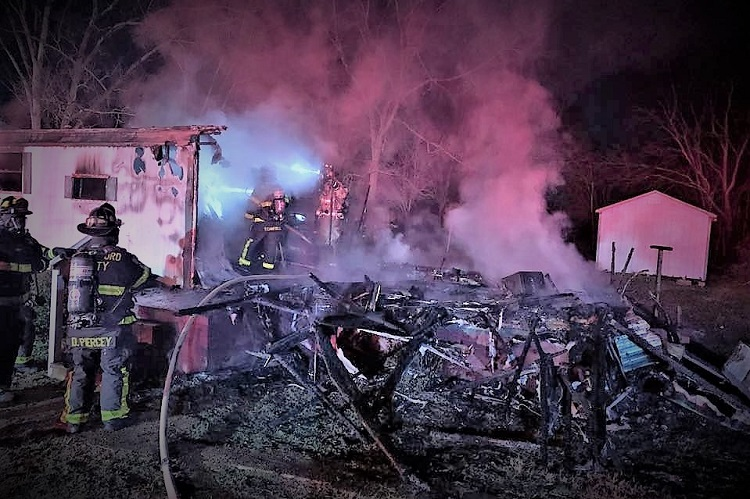 As firefighters arrived at a home around 6:00 o'clock Saturday night, they reported heavy fire coming from the structure.
