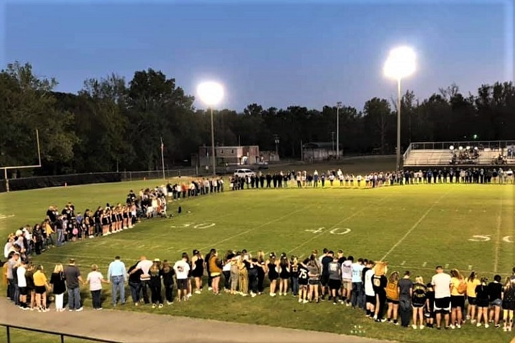 Waynesboro High School, the place that Rockvale's Head Football Coach Rick Rice spent 28-years, came out in strong support for his son Austin at their Friday night football game. The Wildcats organized a prayer circle on the field for their former coach's son.