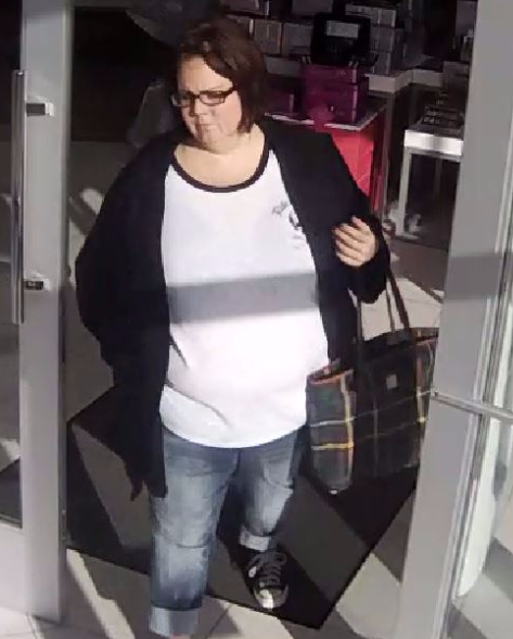 Woman Takes Merchandise from Smyrna Ulta