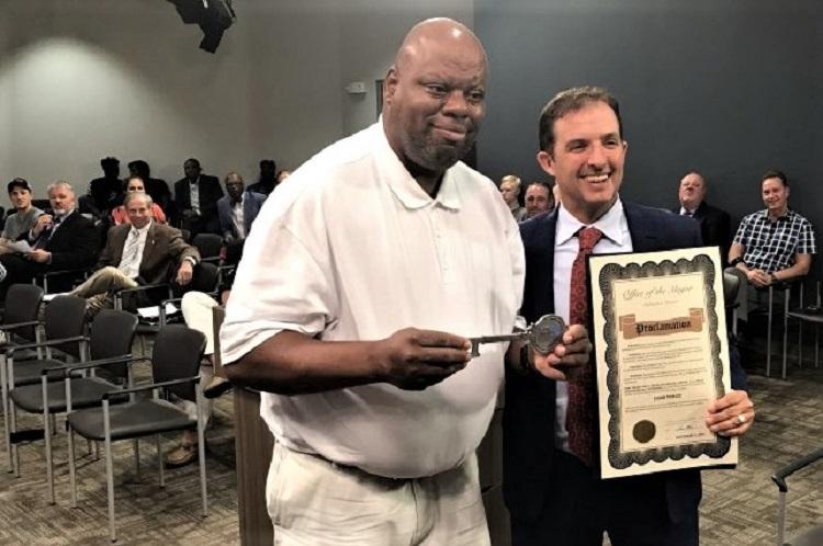 Mayor Shane McFarland awards Murfreesboro man the key to the city for 30+ years of local volunteer work.